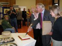 Dennis Dunn MMU cutting cake
